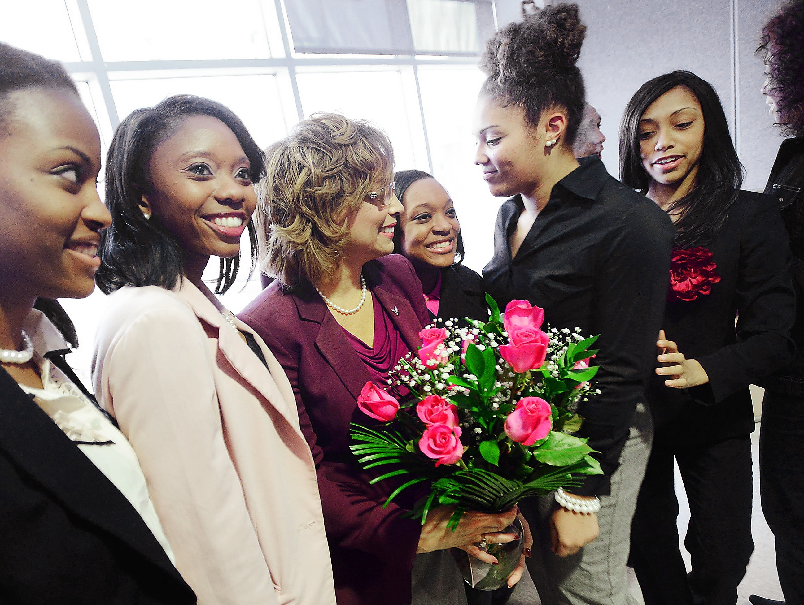 Debra Saunders-White, center, with daughter Elizabeth Paige, right, receives a bouquet from Alpha Kappa Alpha Sorority, Inc. members at North Carolina Central University on Friday, Feb. 8, 2013. Saunders-White is deputy assistant secretary for higher education with the U.S. Department of Education and has been named the 11th chancellor of N.C. Central University. Saunders-White has been selected as the 11th chancellor of North Carolina Central University and will assume her new duties June 1. (AP Photo/The Herald-Sun, Bernard Thomas) MANDATORY CREDIT |