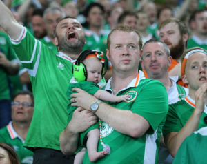 June 22, 2016 - Lille, United Kingdom - An Irish dad brings his baby along to watch the match with ear defenders during the UEFA European Championship 2016 match at the Stade Pierre Mauroy, Lille. Picture date June 22nd, 2016 Pic David Klein/Sportimage |