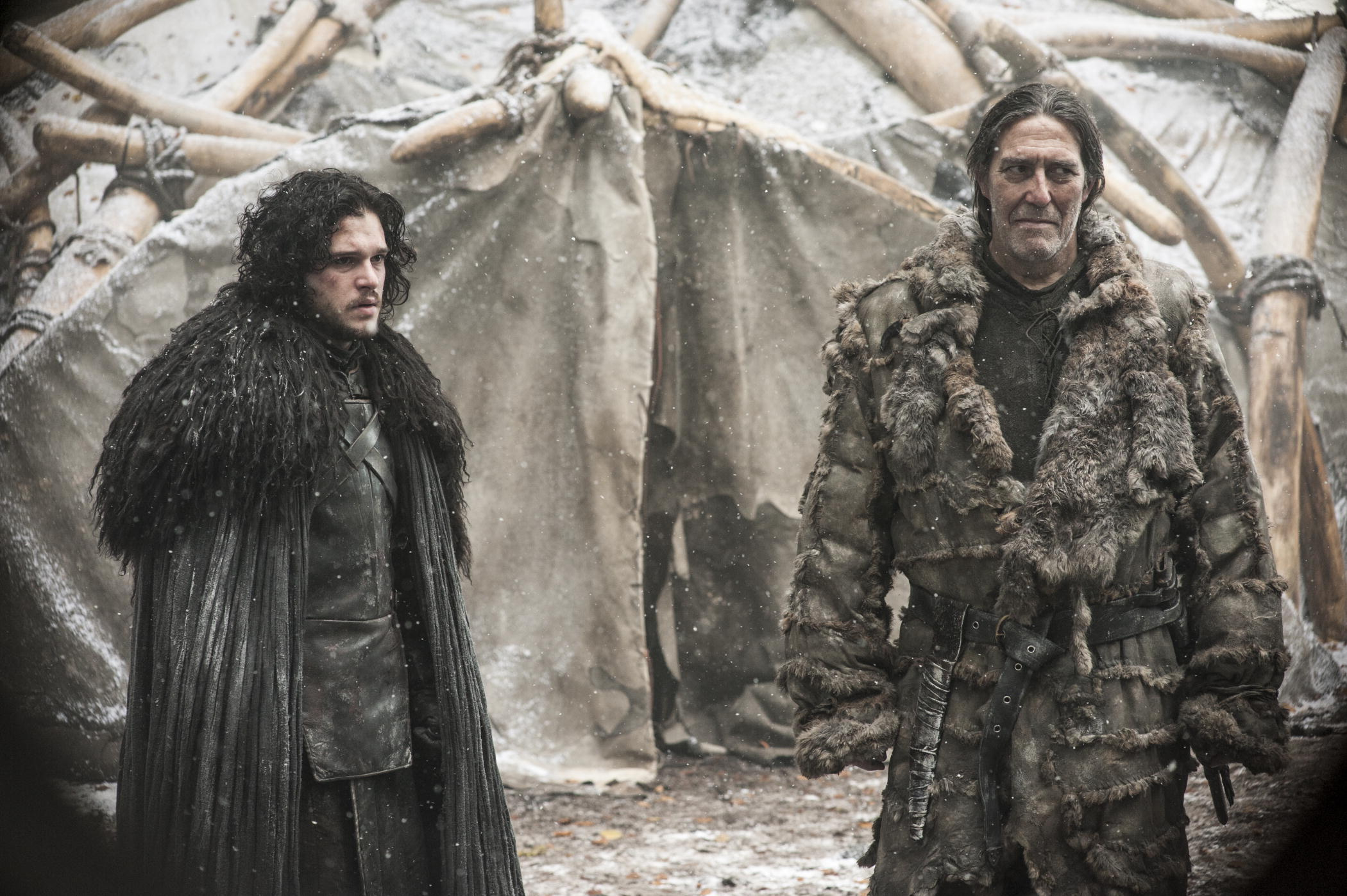 """In this image released by HBO, Jon Snow, portrayed by Kit Harington, left, appears with Mance Rayder, portrayed by Ciaran Hinds in a scene from season four of """"Game of Thrones."""" The season five premiere airs on Sunday. (AP Photo/HBO, Helen Sloan) 