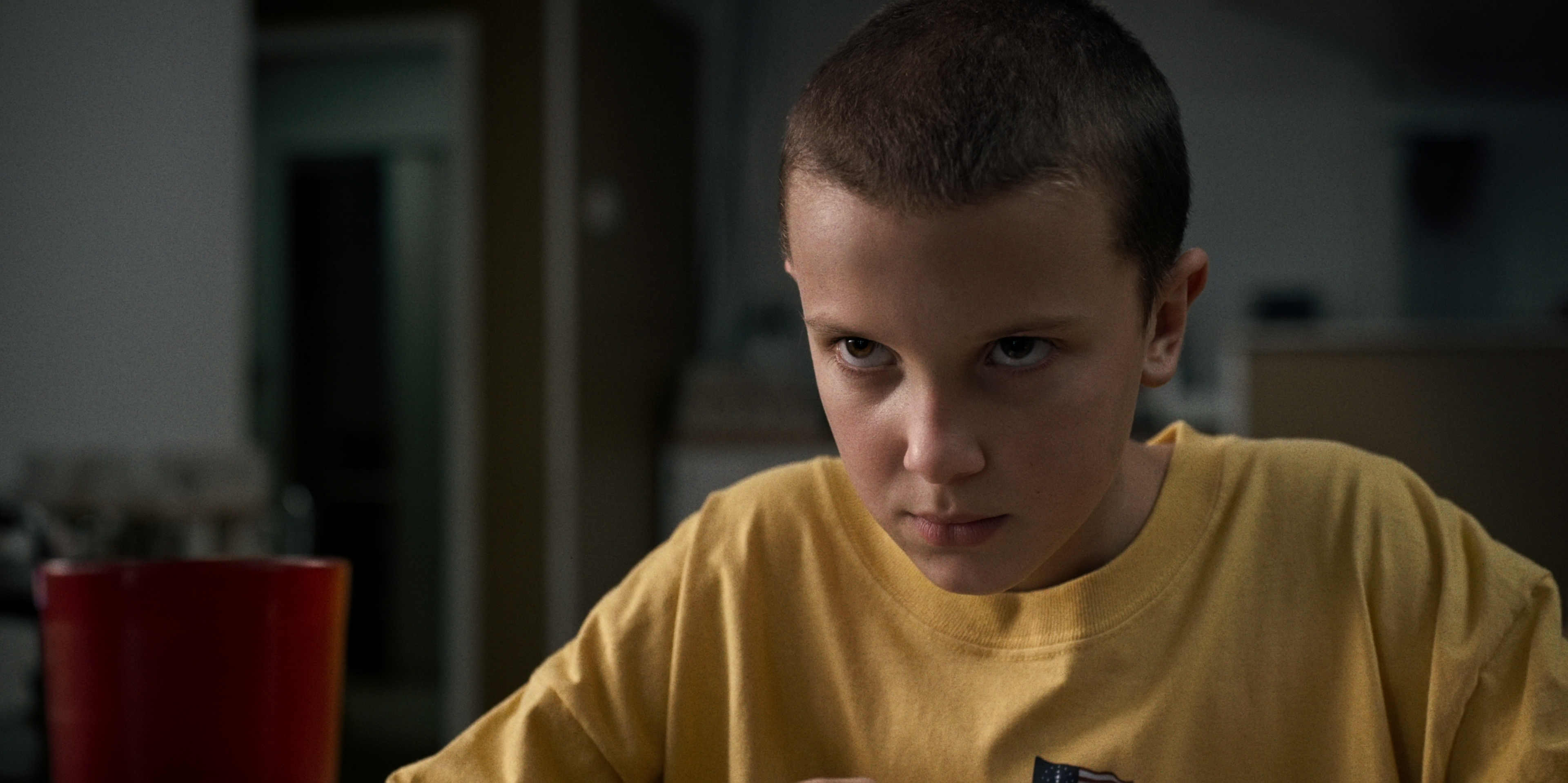 """This image released by Netflix shows Millie Bobby Brown in a scene from, """"Stranger Things."""" The series was nominated for a Golden Globe award for best TV drama on Monday, Dec. 12, 2016. The 74th Golden Globe Awards ceremony will be broadcast on Jan. 8, on NBC. (Netflix via AP) 