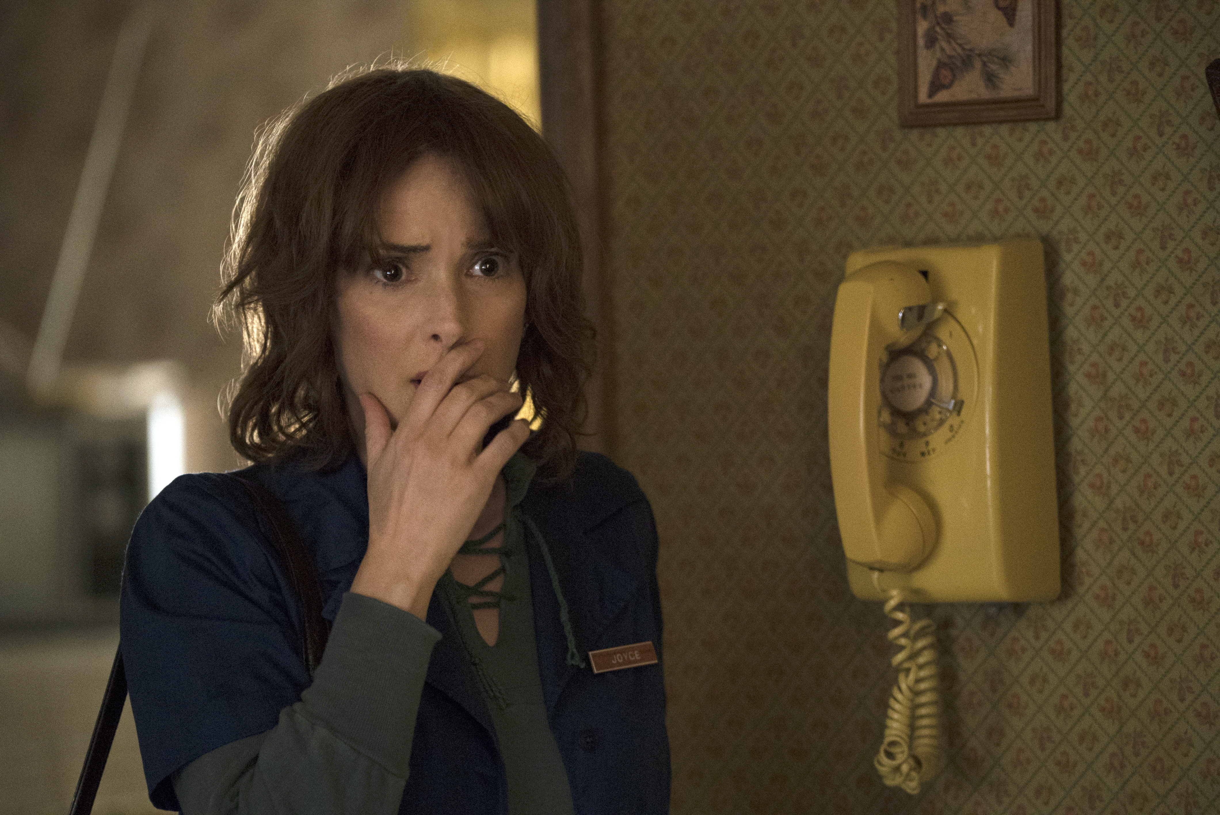 "This image released by Netflix shows Winona Ryder in a scene from ""Stranger Things."" Ryder was nominated for a Golden Globe award for best actress in TV drama on Monday, Dec. 12, 2016. The 74th Golden Globe Awards ceremony will be broadcast on Jan. 8, on NBC. (Curtis Baker/Netflix via AP) 