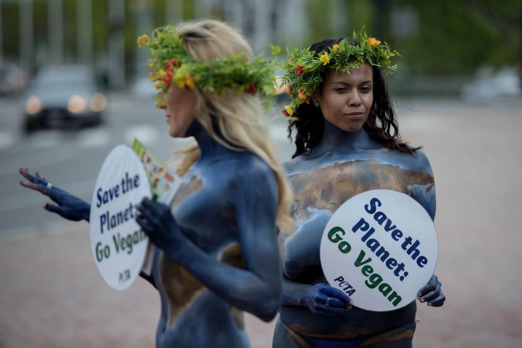 Activists with People for the Ethical Treatment of Animals(PETA), pose in front of Union Station as they celebrate Earth Day and promote a vegan diet in Columbus Circle April 22, 2016 in Washington, DC. / AFP PHOTO / Brendan Smialowski