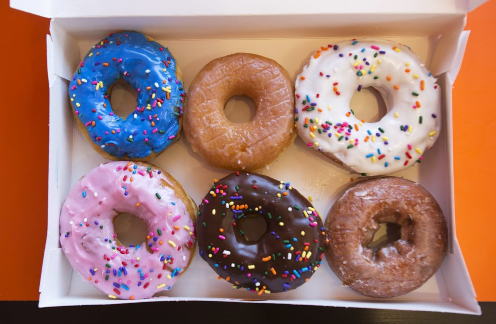 A box of donuts, (from top L clockwise) manager's special, traditional glazed, vanilla, pumpkin, chocolate and strawberry, is pictured at a newly opened Dunkin' Donuts store in Santa Monica, California September 2, 2014. REUTERS/Mario Anzuoni/File Photo GLOBAL BUSINESS WEEK AHEAD PACKAGE - SEARCH 'BUSINESS WEEK AHEAD APRIL 25' FOR ALL IMAGES