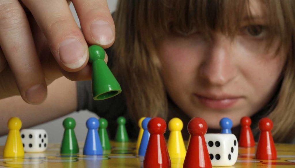 Spielen Spiels beim Kopf des Wir spielen
